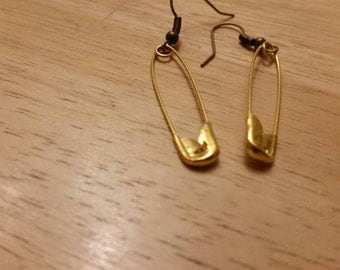 Gold coloured safety pin earrings