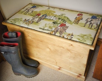Solid Blanket chest upholstered horse and hounds hunting scene.