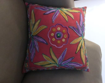 2 red decorative pillows