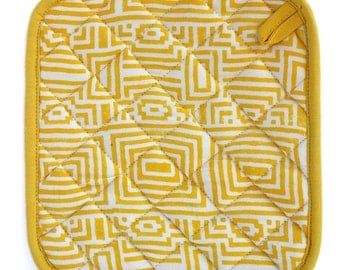 Graphic yellow and white wood-block printed pot holder with piping.