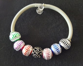 Aluminum balls with a black and silver bead set on a neoprene bracelet