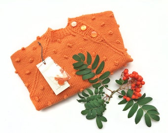 """Sweater Candy. A cozy and warm sweater made for adventures. """"Orange"""""""