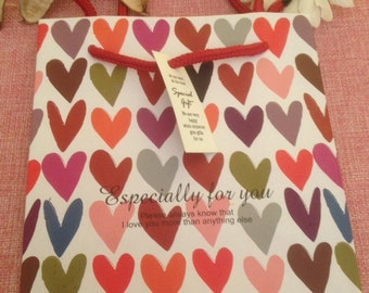 gift bag with coloured hearts with written especially for you