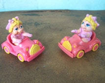 Miss Piggy from the Muppet Babies Series in a Happy Meal Car