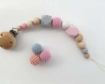 Pacifier in white pink