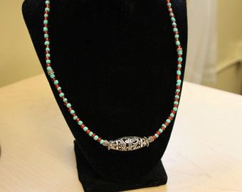 Red and turquoise beaded necklace with silver pendant