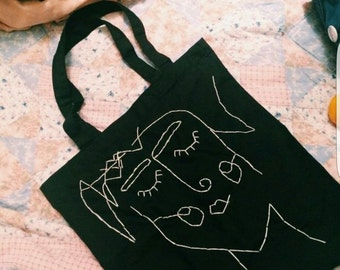 Hand sewn illustration face tote bag