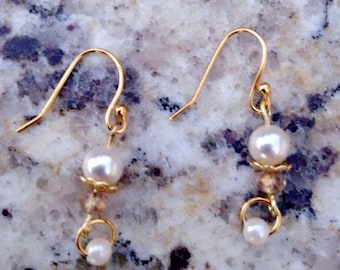 Earnings with Swarovski pearls and gold hooks