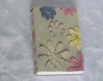 Cream real leather, hand bound book