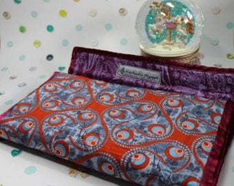 Clutch style baby changing mat