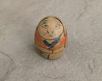 Marble inside Wooden Figurine