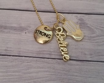 Nickel-free gold colored necklace with 3 charms believe, strong/eye, and Hamsa Hand (protection)