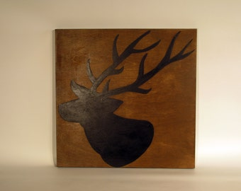 Deer painted on wood canvas