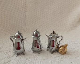Vintage silver salt, pepper and lighter set