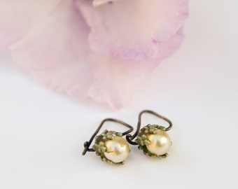 Vintage earings, adorned with artificial pearls.