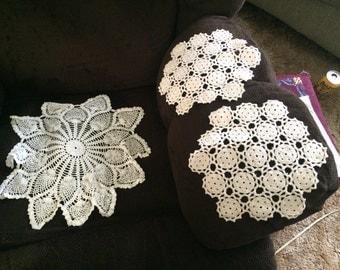 Assorted handmade doilies