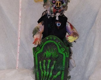 Creepy Zombie doll with tombstone