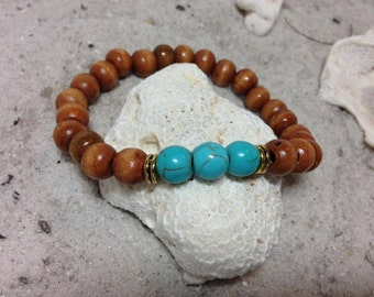 Turquoise Howlite with honey colored wood and gold accents 1312