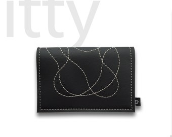 The wallet called itty (shown in BLACK with silver stitching)