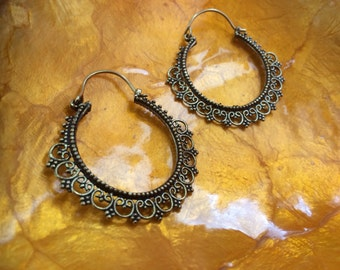 Brass tribal hoop earrings with heart details