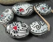 Love is in the air... encased lampwork pebble bead set