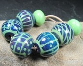 Multicolor Dark round lampwork beads with fine lime stringer detail