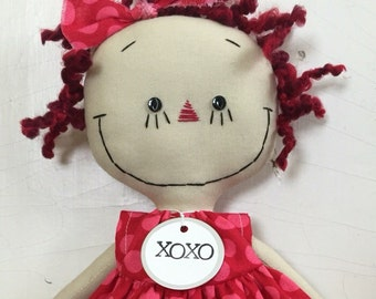 handmade cloth rag doll Raggedy Ann In pink and red polka dots