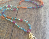Gemstone Hamsa Charm necklace hand knotted on silk. One of a kind. Multi gemstone protection necklace.
