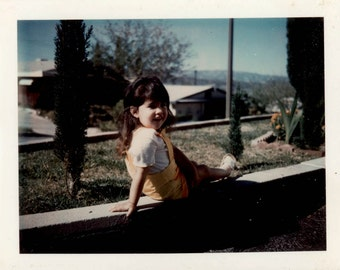 Vintage photo 1972 Color w backing Snapshot Little Girl Posed on Wall