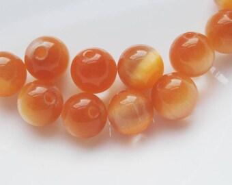 Orange Glass Cats eye 10mm beads x 10 destash