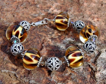 "Sterling Silver ""Animal Print"" Lampwork Bracelet by koregon"