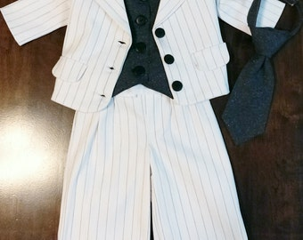 Boys size 5-8 Suit 3 piece suit has Jacket, Vest, Long pants with optional add on pieces