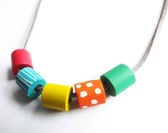 Scandinavian pop bright rainbow necklace wooden hand painted unique white polka dot stripe