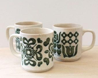Set of three vintage 1970s  folk art stoneware mugs.