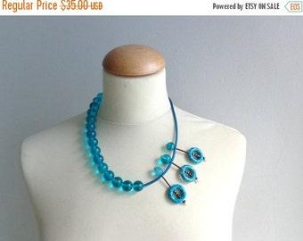 Blue asymmetric statement necklace