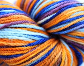 hand-dyed self-striping yarn / sport weight yarn / superwash merino wool / fox colorway / orange, light blue, cobalt, plum