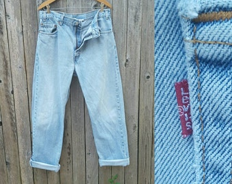 """Vintage Levi's 505 Jeans  //  Vtg 80s 90s Levis Made in the USA Distressed Faded Light Wash Indigo Denim Jeans  //  35"""" waist"""