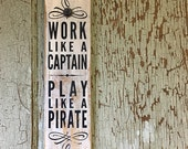Work Like a Captain-Play Like a Pirate sign on reclaimed dresser panel by Old Barn Rescue Company