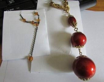 2 orange bead necklaces