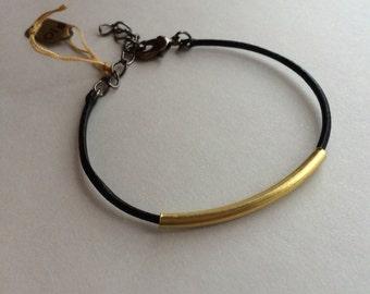 Black skinny leather with brass bracelet