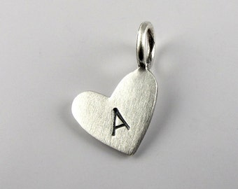 Tiny silver heart pendant with initial