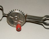 Vintage Child Betty Taplin Beater Toy Metal Hand Crank Beater with Red Wood Handle