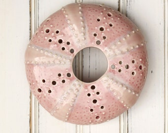 large urchin wall hanging, urchin tabletop sculpture, pink