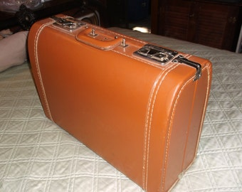 "Vintage Luce Suitcase Luggage 19"" wide, 14"" deep, and 7.5"" thick"