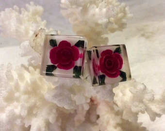 1950s acrylic screw back earrings with felted roses inclusions.