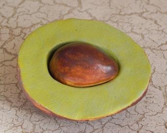 porcelain avocado half, and pit, original sculpture, faux food
