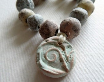 Artisan made ceramic beads - set of 14 - faded colors - S to M