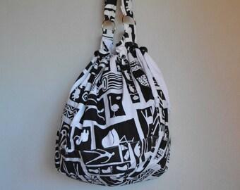Drawstring bag bucket bag beach tote silk screened white and black African lined handmade