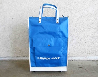 Vintage Pan Am Tote Bag in Dark Blue with Wheels. Circa 1960's.
