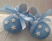Blue with white stars felt baby shoes.